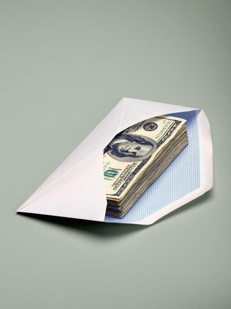 envelope with $100 bills