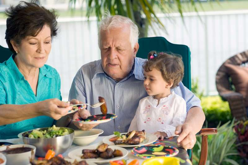 Grandfather at table of food