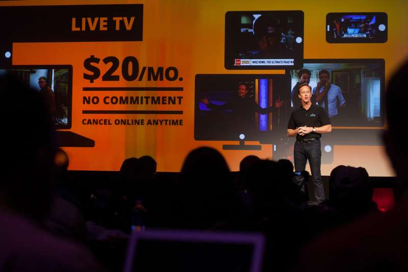Roger Lynch, chief executive officer for Sling TV LLC, speaks at a press conference during the 2015 Consumer Electronics Show (CES) in Las Vegas, Nevada, U.S., on Monday, Jan. 5, 2015. Dish Network Corp. plans to unveil the first major online television service from a cable or satellite company, a $20-a-month set of 12 channels that targets U.S. customers who don't want to pay for larger, more expensive TV packages. ]