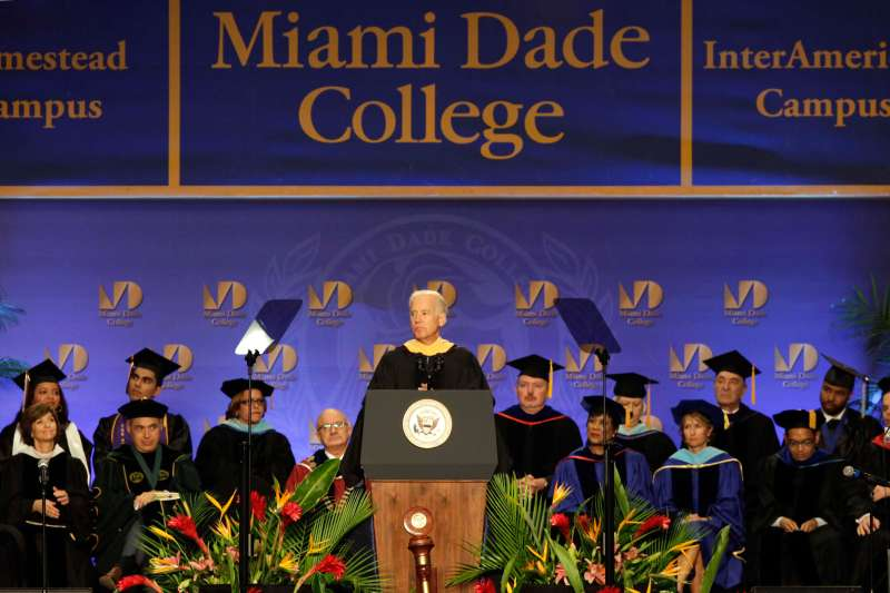 Vice President Joe Biden, center, speaks during a graduation ceremony at the Miami Dade College in Miami, Saturday, May 3,2014.