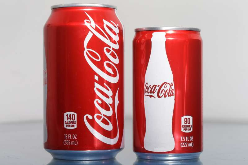 A 7.5-ounce can of Coca-cola, right, is posed next to a 12-ounce can for comparison.