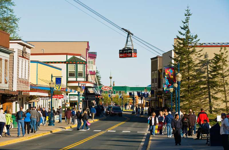 South Franklin Street with Mount Roberts tram car passing overhead in Downtown Juneau, Alaska.