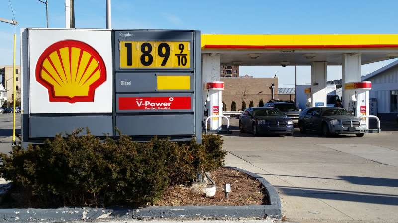 Cars fill up at the pumps at a Shell station near downtown Detroit, where the sign shows the price at $1.899 a gallon on Thursday, Jan. 1, 2015