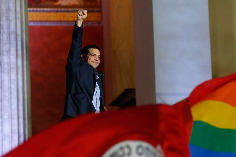 The head of radical leftist Syriza party Alexis Tsipras waves to supporters after winning the elections in Athens January 25, 2015. Tsipras promised on Sunday that five years of austerity,  humiliation and suffering  imposed by international creditors were over after his Syriza party swept to victory in a snap election on Sunday.
