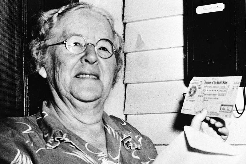 In this Oct. 4, 1950 file photo, Ida May Fuller, 76, displays a Social Security check for $41.30 that she received at her home in Ludlow Vt. On Jan. 31, 1940, Fuller received the country's first Social Security check for $22.54. By the time she died in 1975 at age 100, she had received nearly $23,000 in benefits.