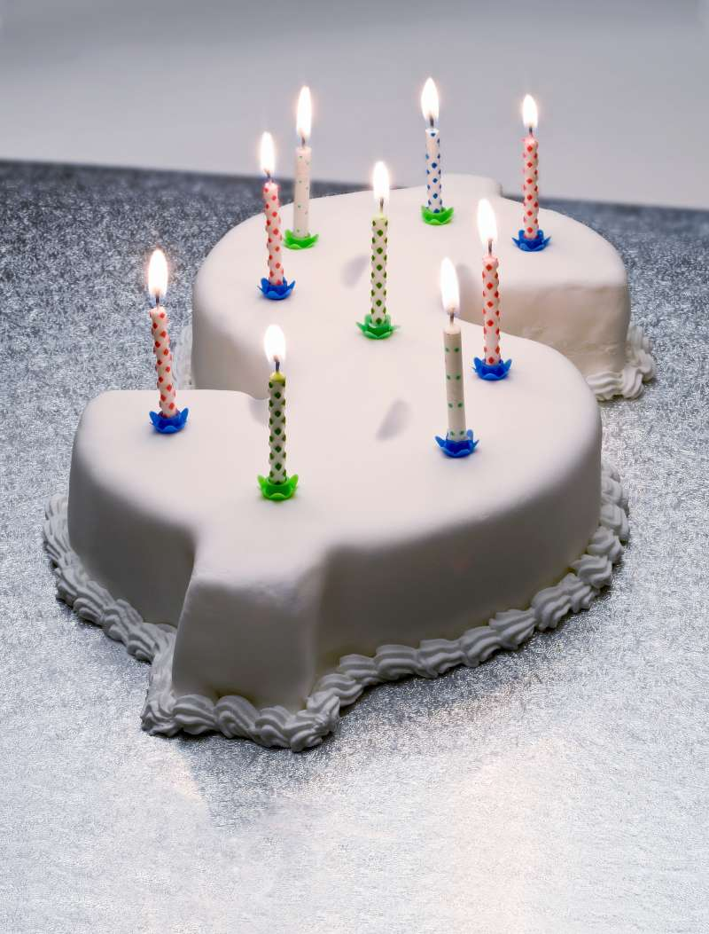 Dollar sign birthday cake with candles on top