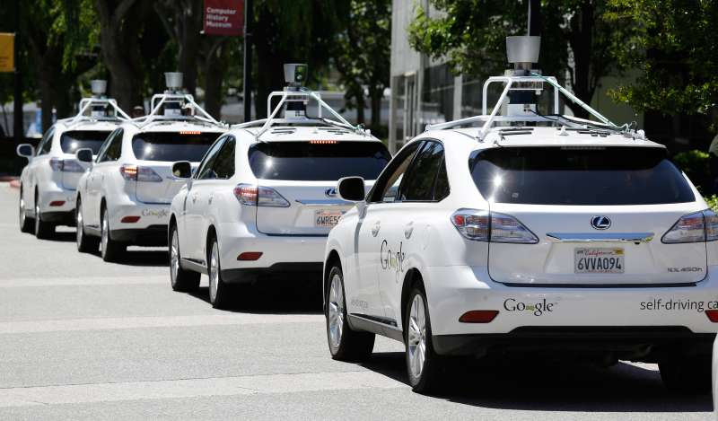 A row of Google self-driving cars in Mountain View, California