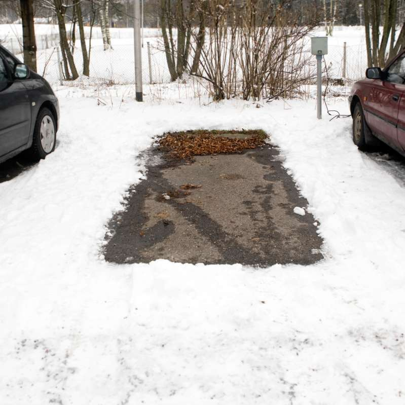 empty parking space and snow