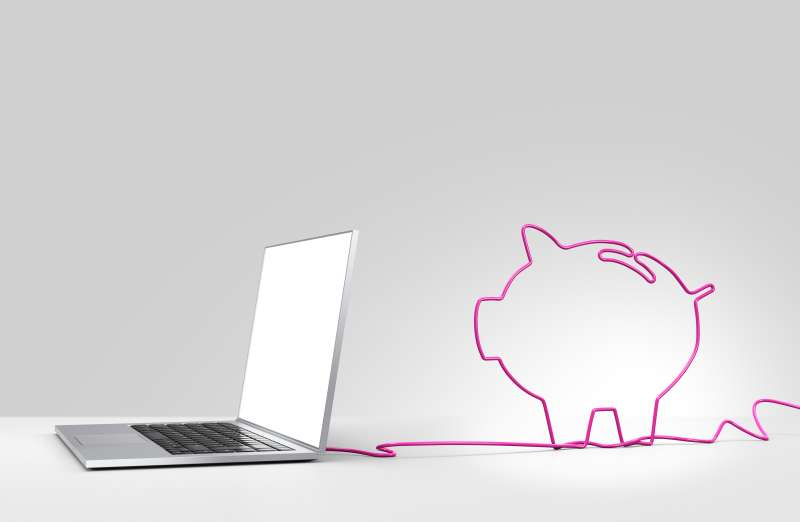 laptop with cord in shape of piggy bank