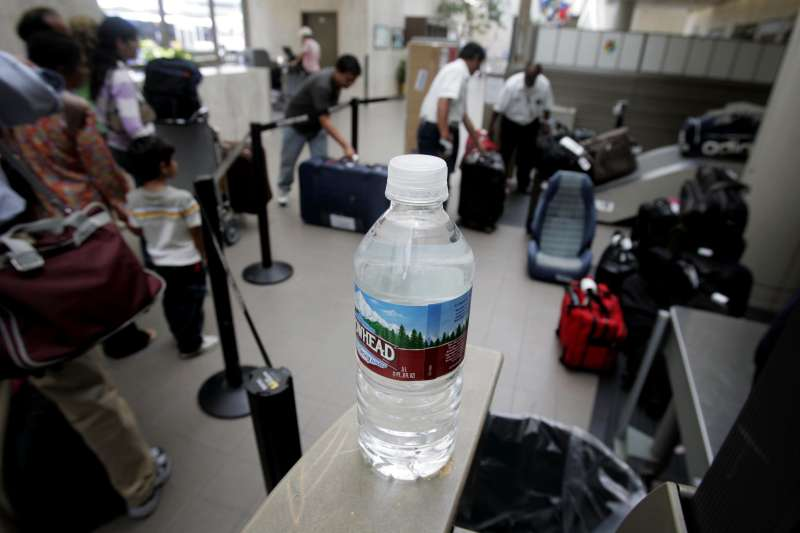Water near a checked-baggage inspection station at Terminal One at Los Angeles International Airport.