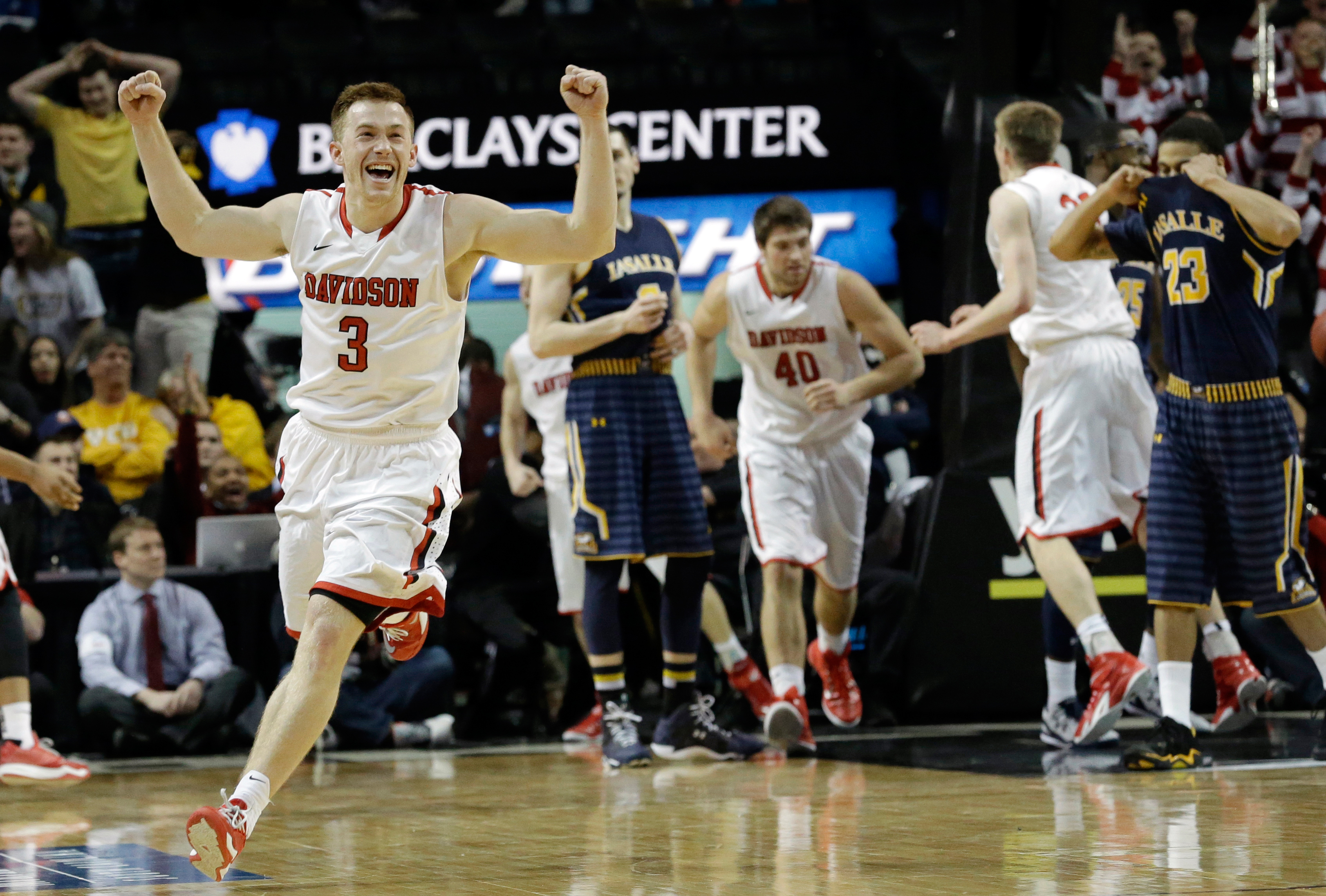 Davidson guard Brian Sullivan (3) celebrates after their 67-66 win over La Salle in an NCAA college basketball game in the quarterfinals of the Atlantic 10 Conference tournament in New York, Friday, March 13, 2015.