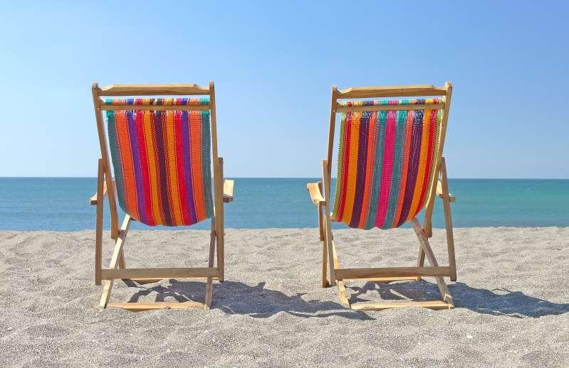 Beach chairs on sand