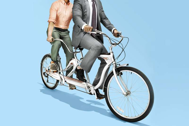 two people the same bike