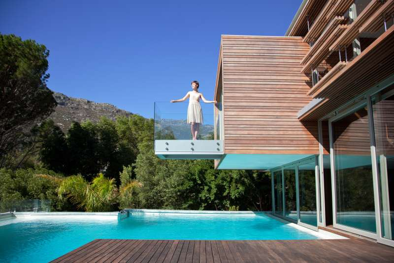 woman on balcony of modern house
