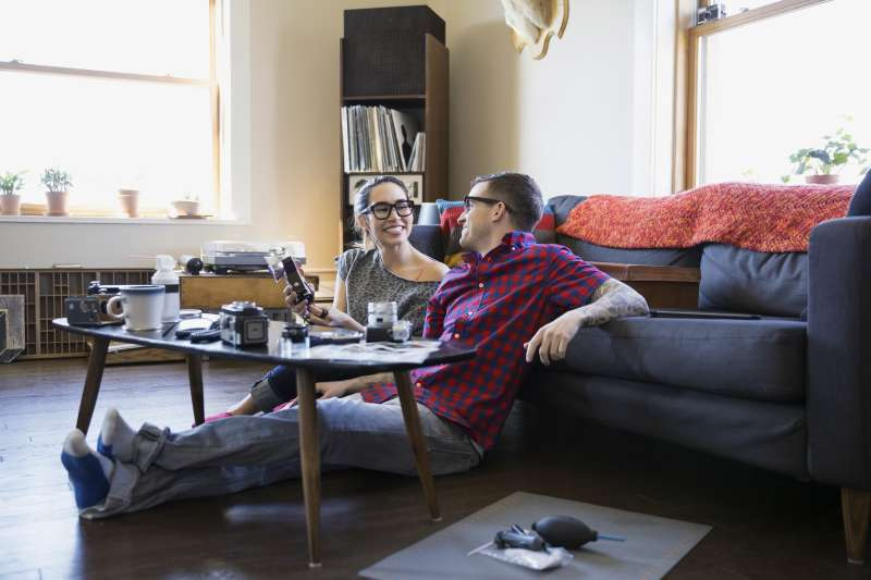 young hipster couple in apartment