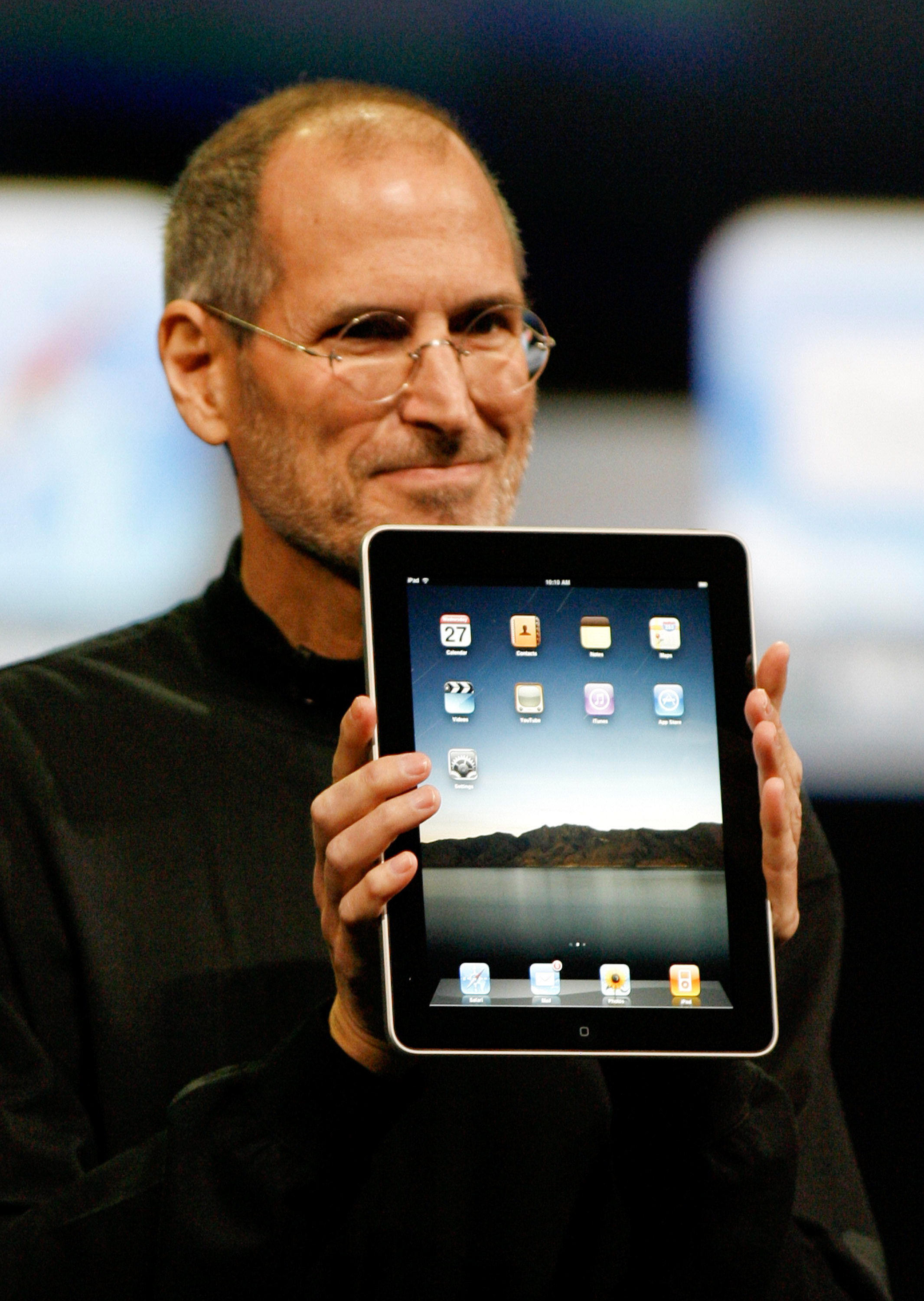 Apple CEO Steve Jobs holds an Apple iPad tablet during its debut at the Yerba Buena Center for the Arts Theater in San Francisco. The iPad would launch on April 3, 2010, with a price tag of $499.