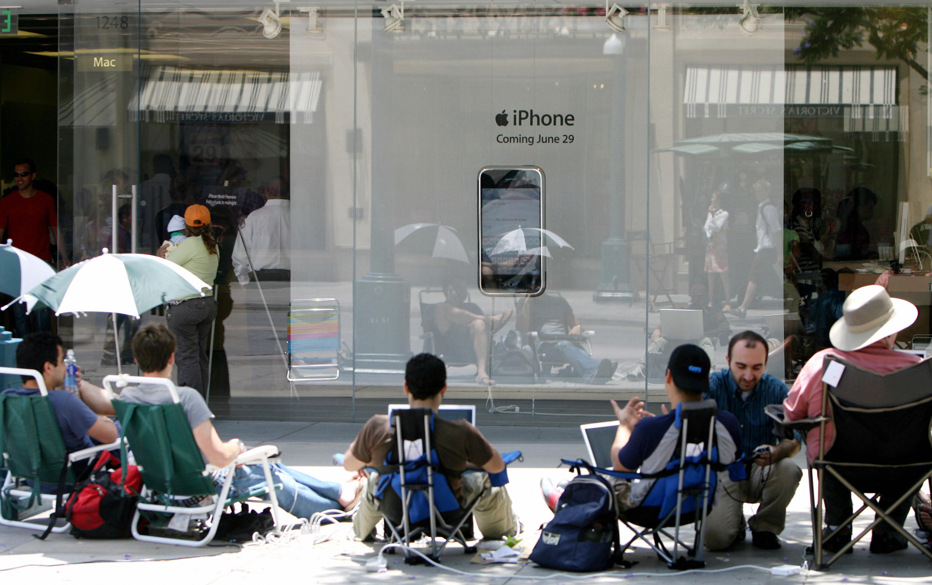 People wait outside an Apple store on  June 28, 2007, in Santa Monica, California for the iPhone, scheduled to be released at 6:00 pm the next day.
