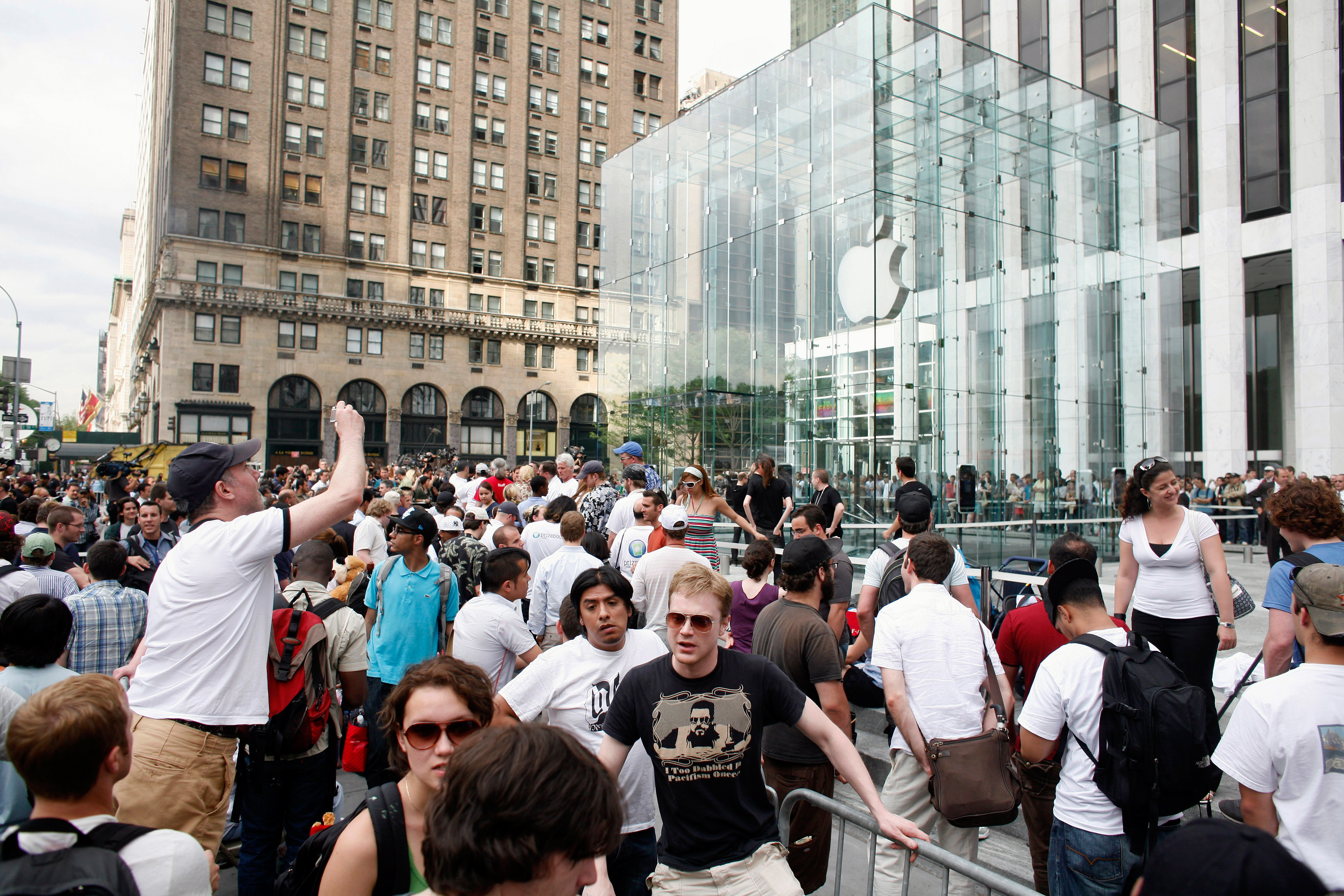People line up to be the first to buy an iPhone at Apple's flagship store on Fifth Avenue on June 29, 2007, in New York City.