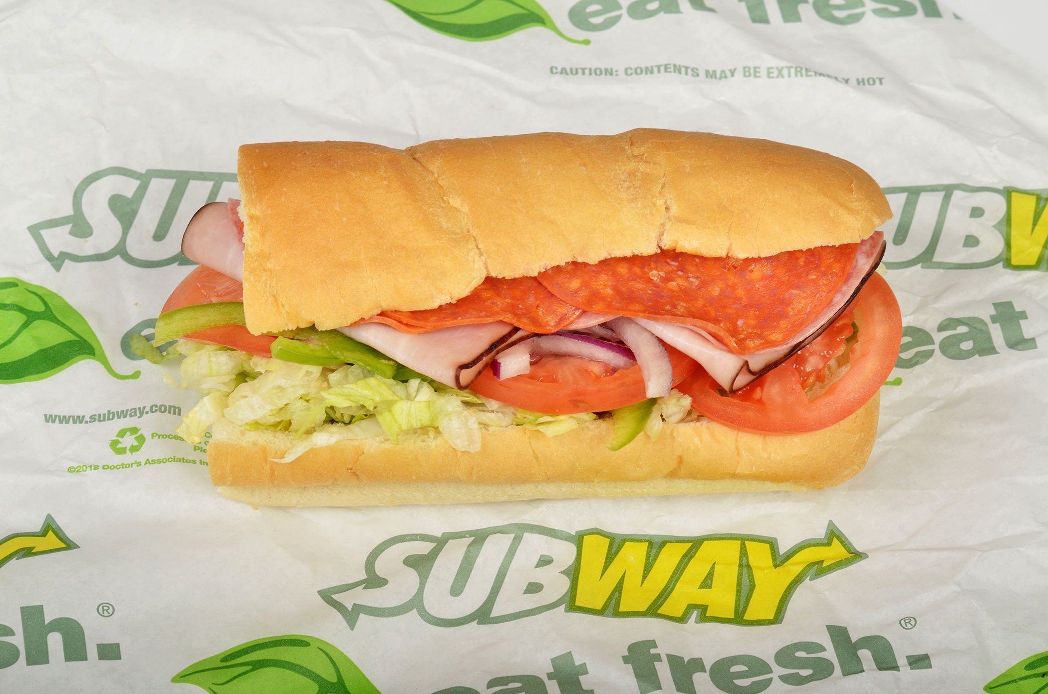Subway BMT sub sandwich on italian roll with Genoa Salami, Black Forest Ham, Pepperoni, lettuce, tomato, red onion on roll.