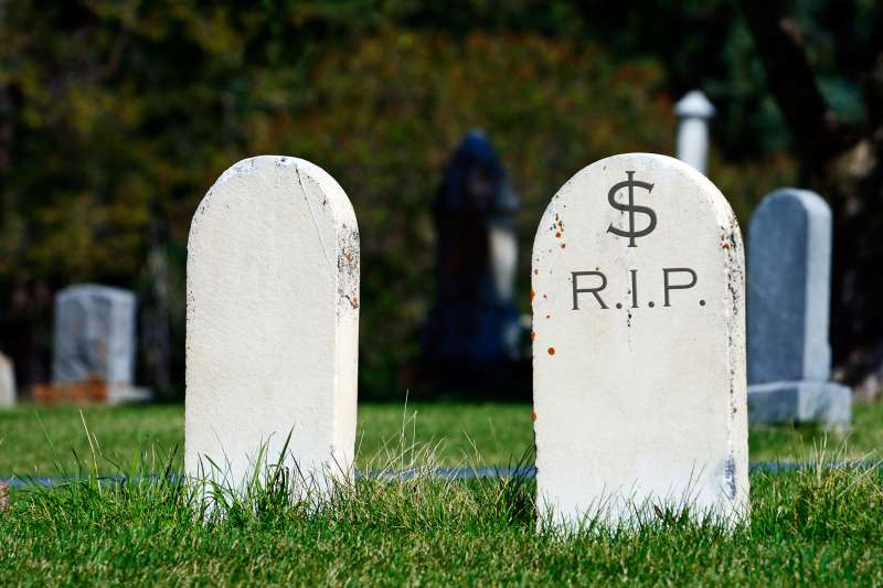 two tombstones, one saying $-RIP