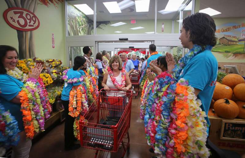 Robin Gallo (center) of North Palm Beach attended the opening on the new Trader Joe's store in Palm Beach Gardens store Friday, September 19, 2014. ''I got here at 6am and was the first in line, '' she said. ''I am using half a vacation day for this.
