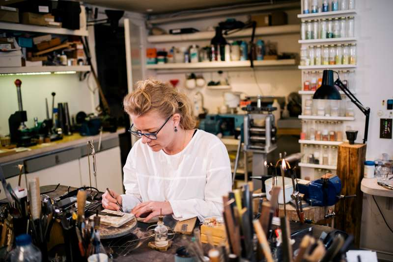 woman working on jewelry in shop