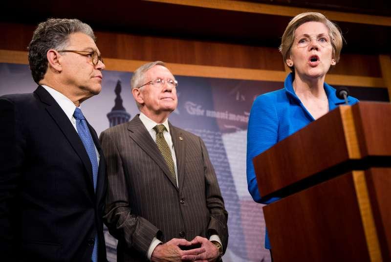 Sen. Al Franken, D-Minn., Senate Majority Leader Harry Reid, D-Nev., and Sen. Elizabeth Warren, D-Mass., hold their news conference following the failed vote on student loan reforms on Wednesday, June 11, 2014.