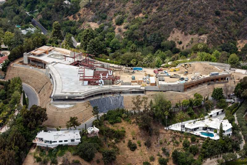 Construction continues at a home being built by Nile Niami, a film producer and speculative residential developer, in this aerial photograph taken in Bel Air, California, U.S., on Monday, May 18, 2015. Niami, who hopes to sell the house for a record $500 million, is pouring concrete in L.A.s Bel Air neighborhood for a compound with a 74,000-square-foot (6,900-square-meter) main residence and three smaller homes, according to city records.
