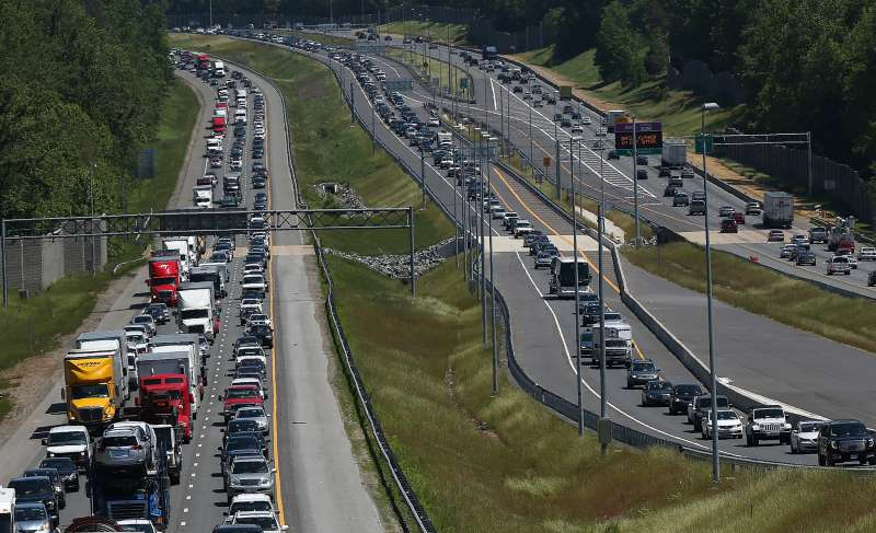 Heavy Memorial Day traffic moves southbound and northbound along I-95 May 22, 2015 in Quantico, Virginia.