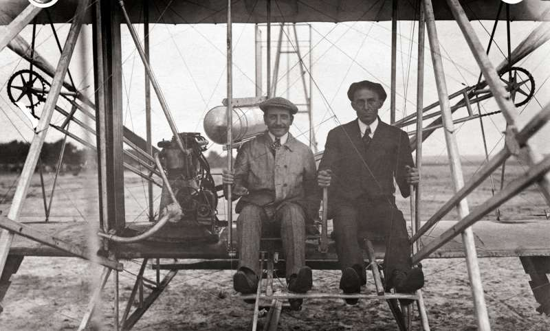Wilbur Wright, American pioneer in aviation, and Paul Zens, famous French flier, preparing for two man flight in Le Mans, France, September 16, 1908.