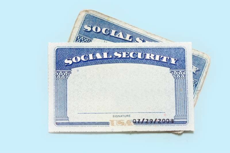 New social security card on top of old one