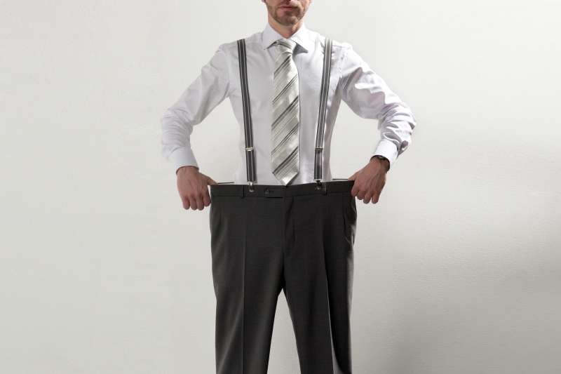 man with too large pants