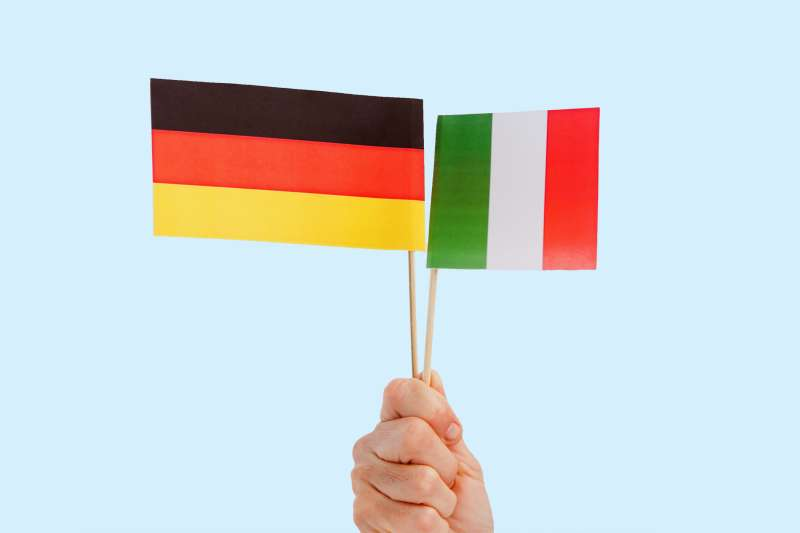 woman holding Italian and German flags