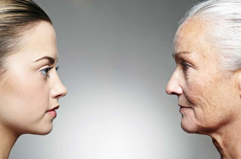 old woman facing younger woman in profile