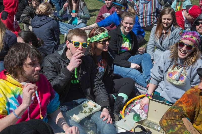 crowd of people smoking marijuana