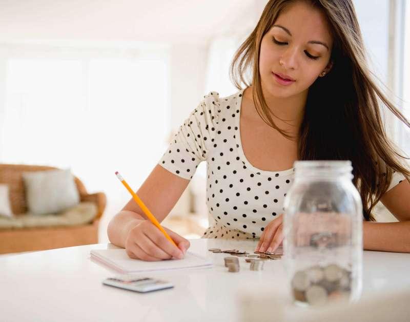 woman counting her savings