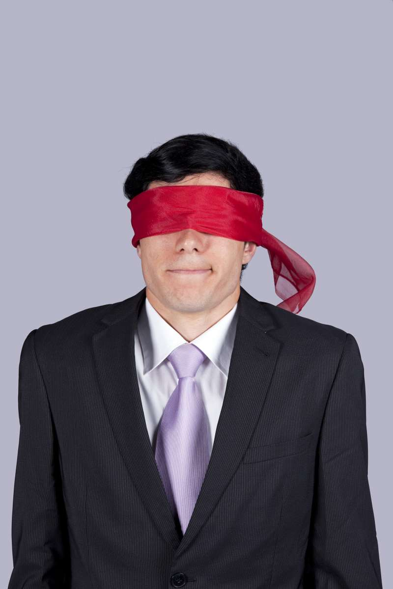 blindfolded man in suit
