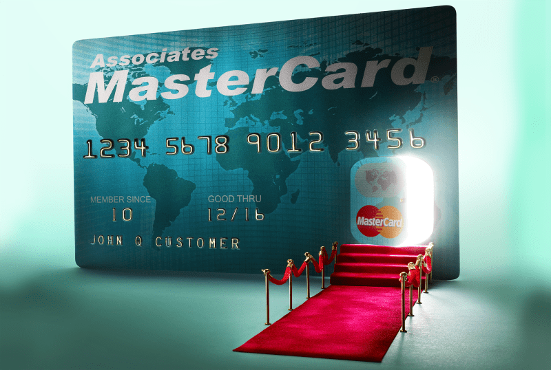 credit card with door cut out and red carpet