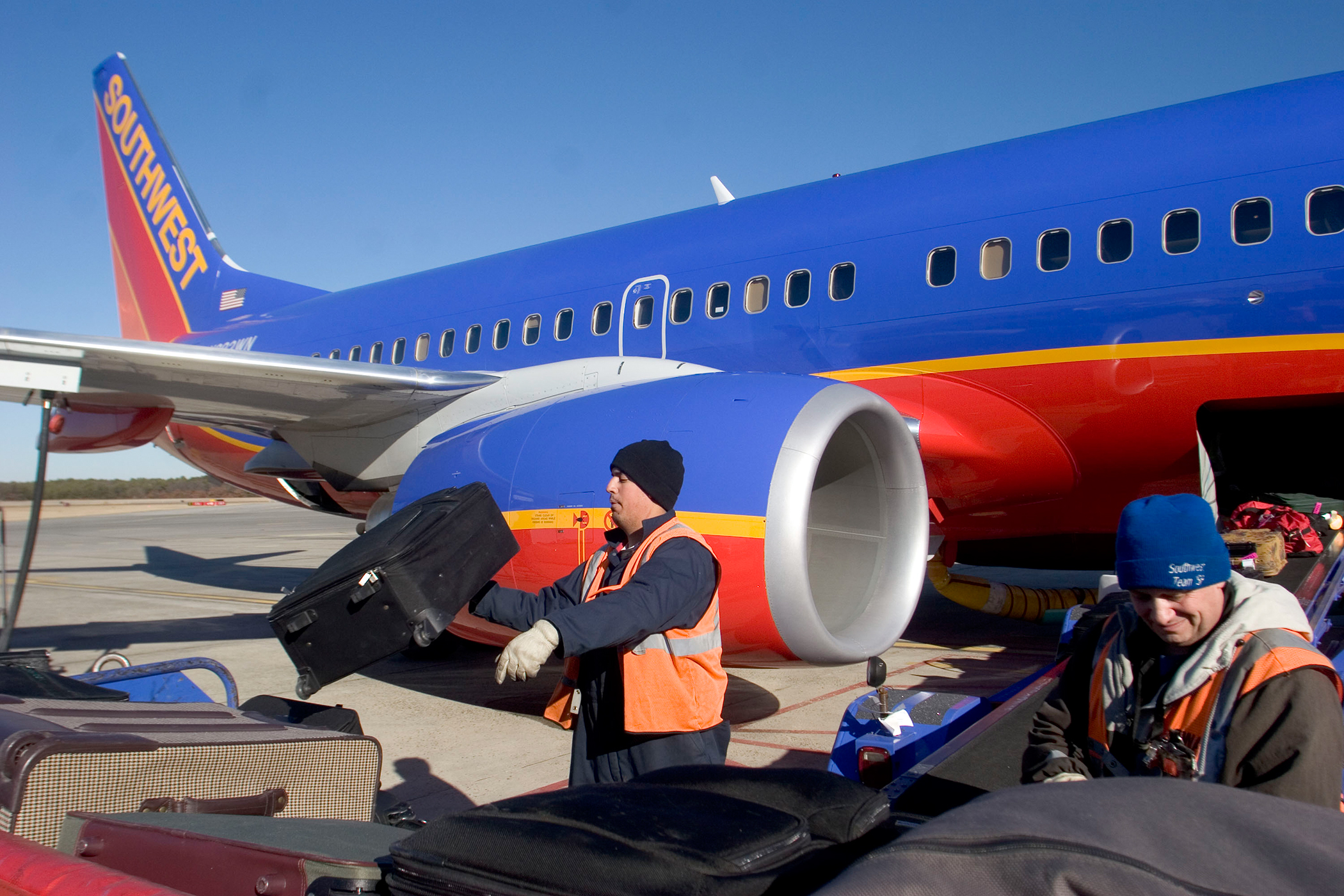 Southwest Airlines luggage handlers tossing bags