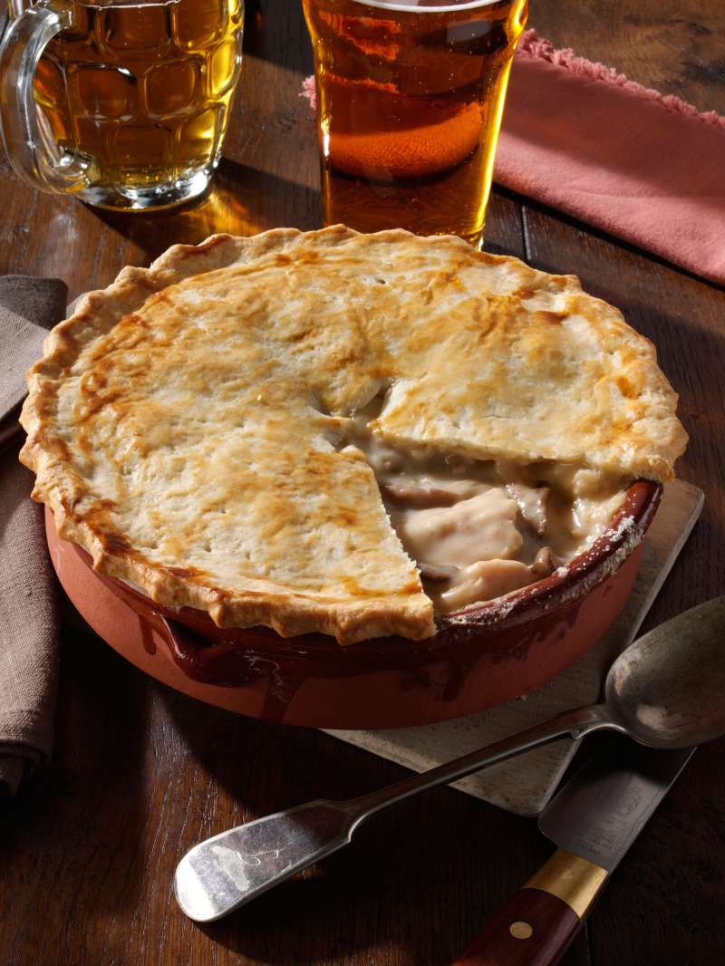 Pie with pint glasses of beer