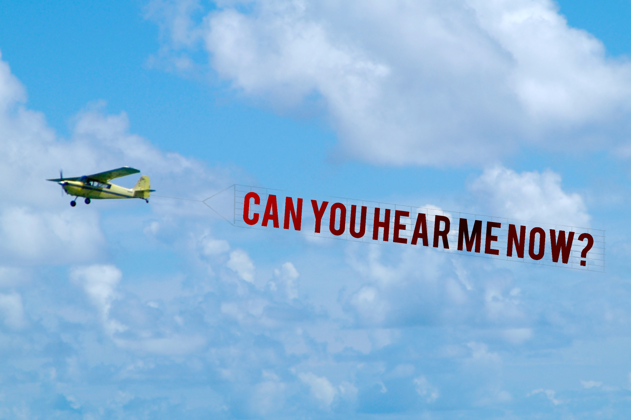 """airplane with banner flying behind it that reads """"can you hear me now?"""""""