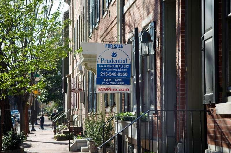For Sale  sign outside town home in Society Hill neighborhood, Philadelphia, Pennsylvania