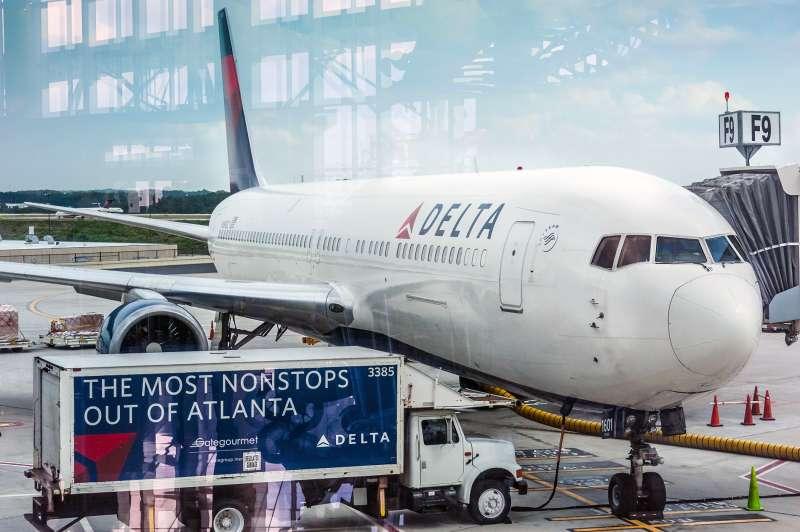Delta Airlines passenger jet and service truck at Atlanta International Airport in Atlanta, Georgia, 2014.