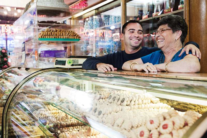 mother and son in deli patisserie store