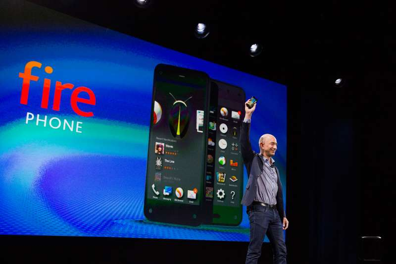 Jeff Bezos, chief executive officer of Amazon.com Inc., unveils the Fire Phone during an event at Fremont Studios in Seattle, Washington, U.S., on Wednesday, June 18, 2014.