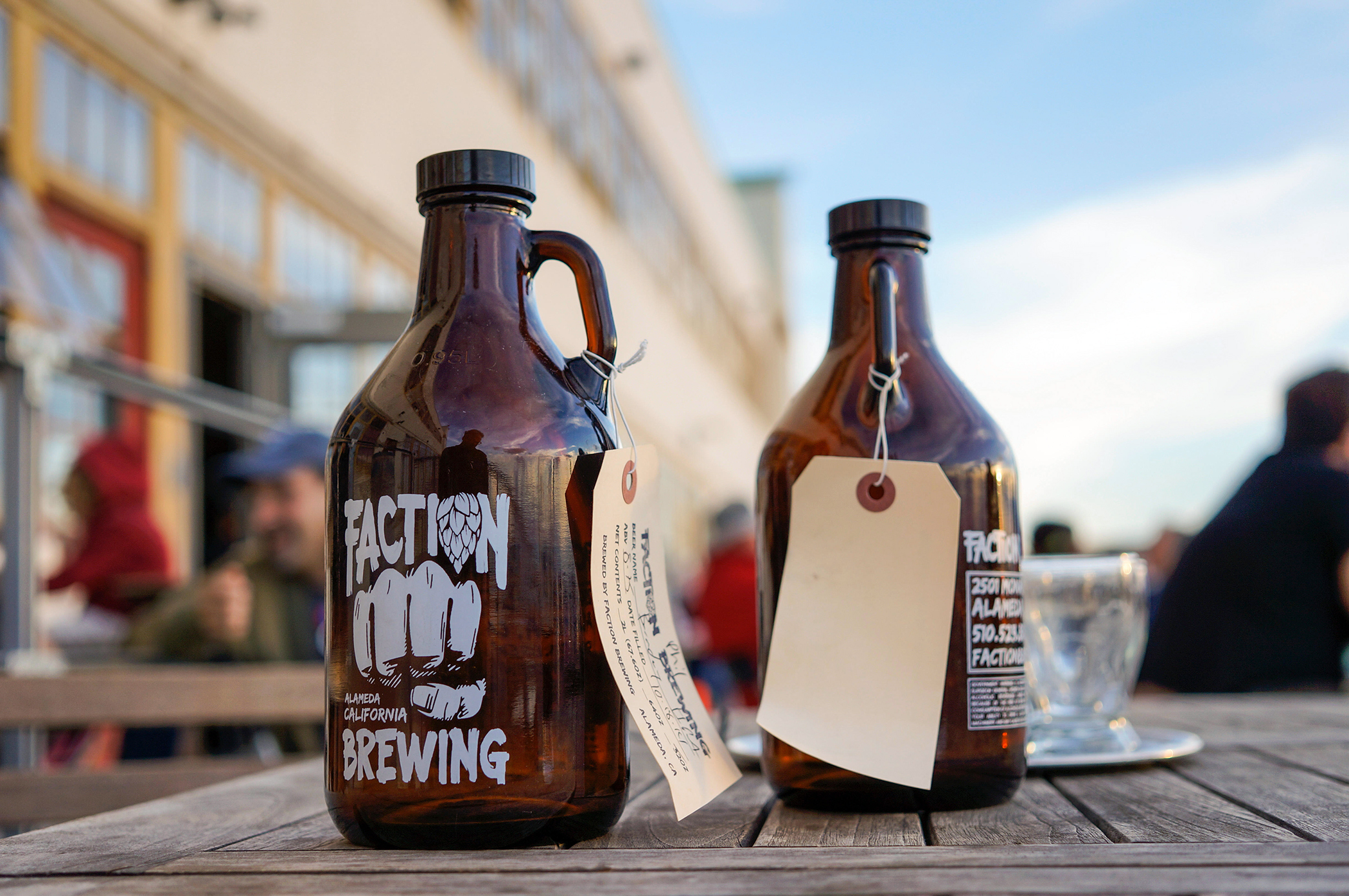 Growlers on a table outside Faction Beer Brewery, Alameda, California
