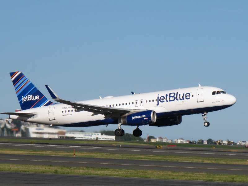 JetBlue plane taking off from runway