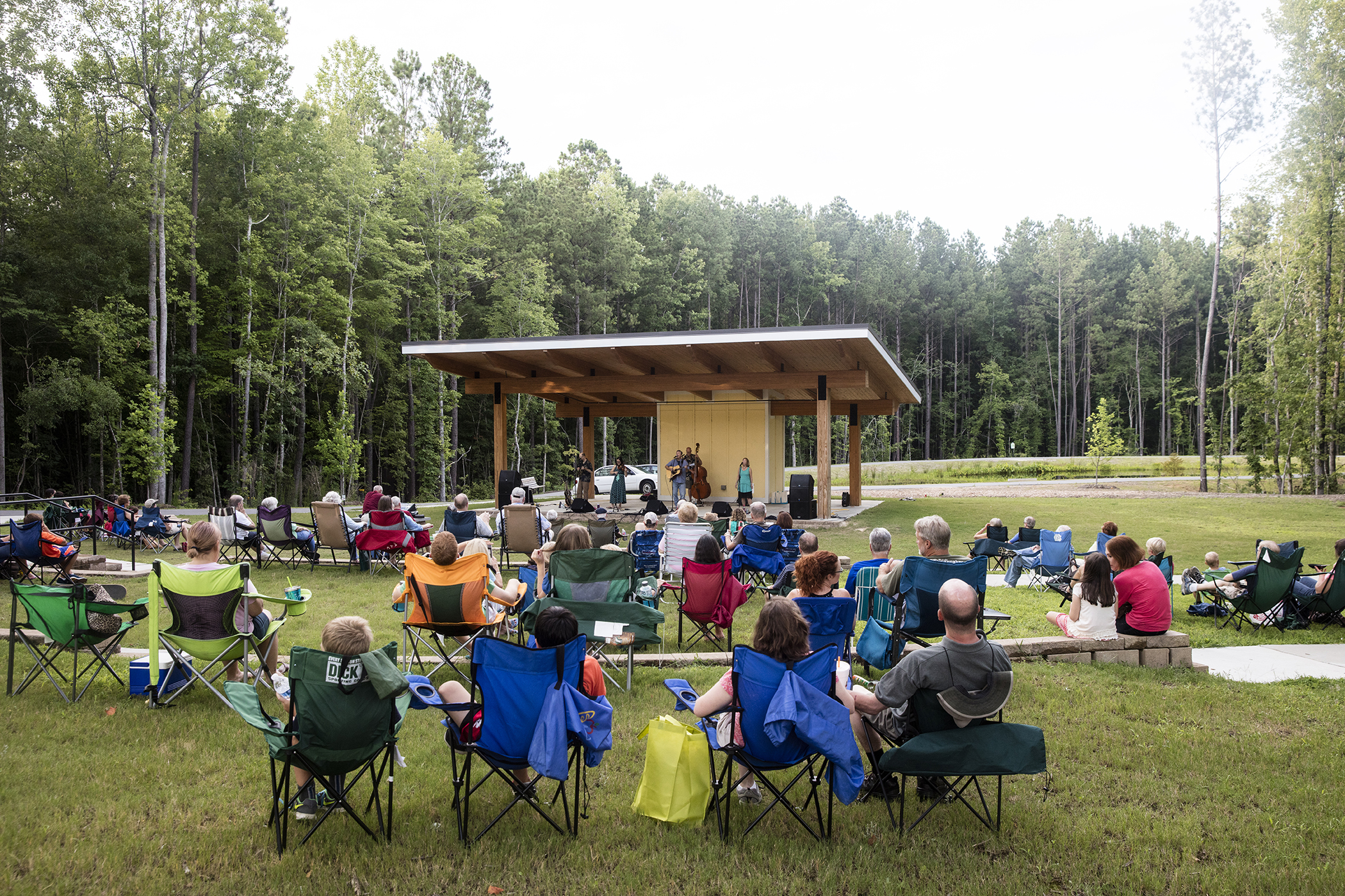 A crowd takes in a free concert by the Swift Creek Band at the Nature Park Amphitheater in Apex, NC