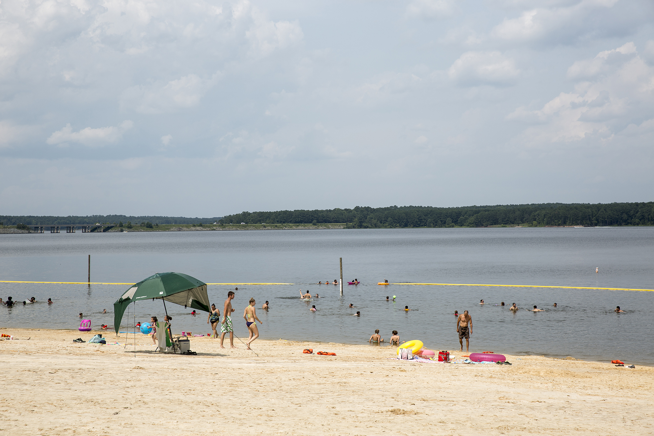 Visitors enjoy the beach at the Jordan Lake State Recreation Area outside of Apex, NC