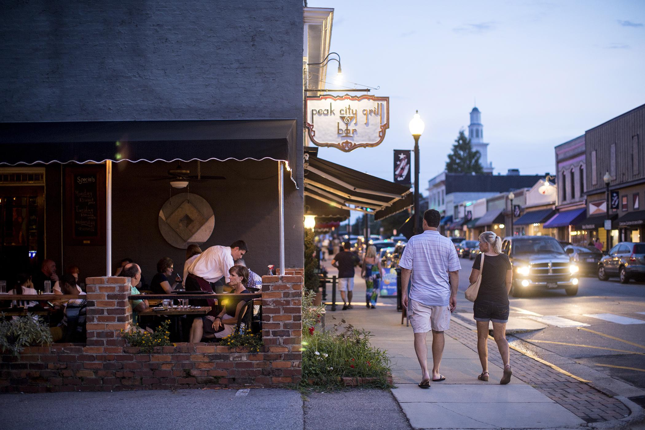 Visitors enjoy a nice evening along Salem Street in downtown Apex, NC